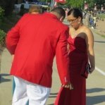 couple dressed in red prom outfit, love display