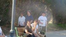 people sitting standing on boardwalk,photos