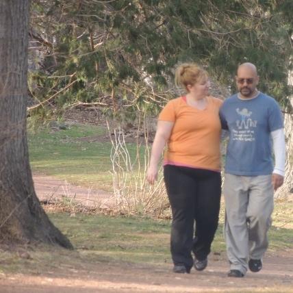 hugging together couple walking in park,images