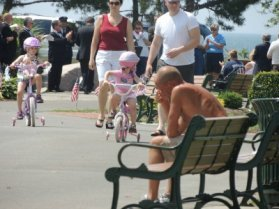 toddlers riding tricycle on boardwalk,photos