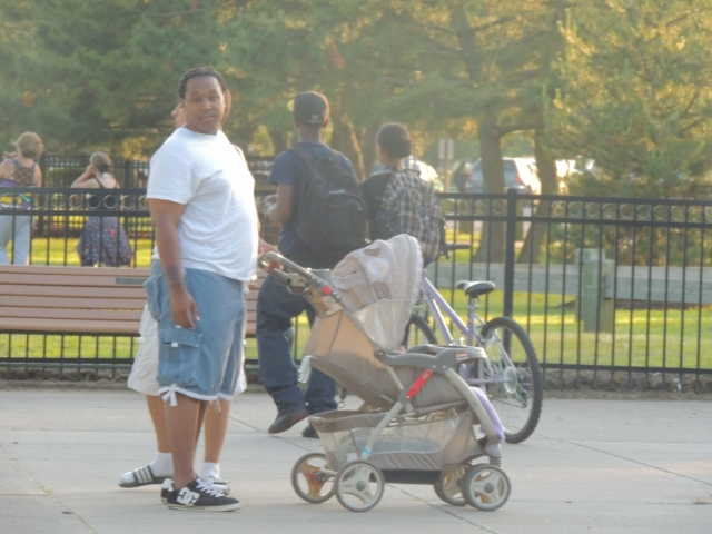 dad pushing baby carriage, newborn baby