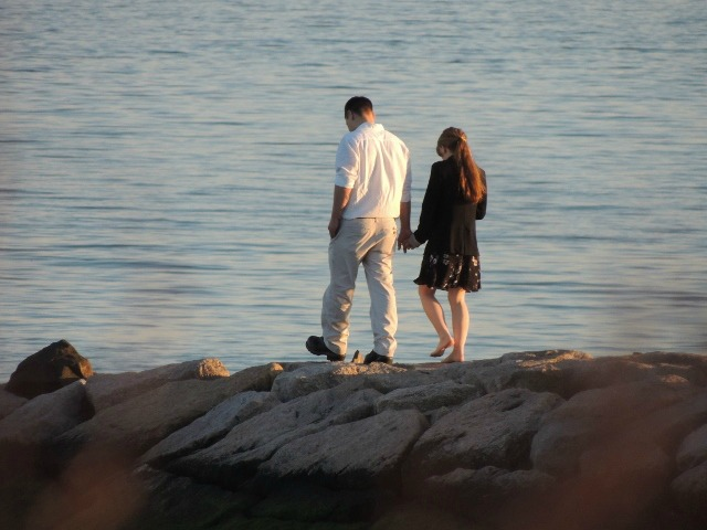 Asian couple walking on pier together,photos,images
