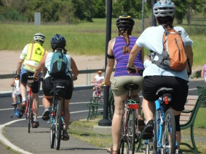 group of young people biking together, pictures