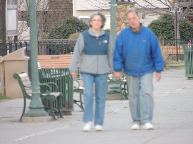 couples in blue walking together,images