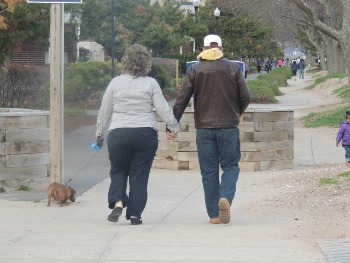 couples walking a dog,dog products ideas
