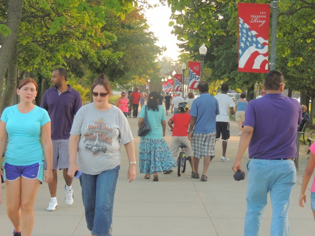 family friends walking on boardwalk,love pics