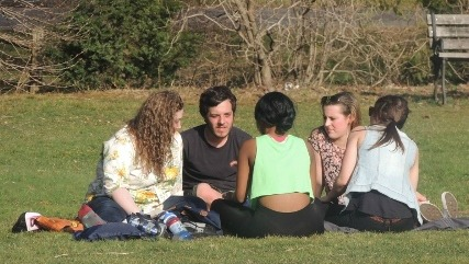 friends sitting on grass together,display of love pic