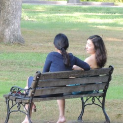 friends sitting together on bench talking,pictures