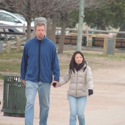 loving couple walking together on boardwalk, images