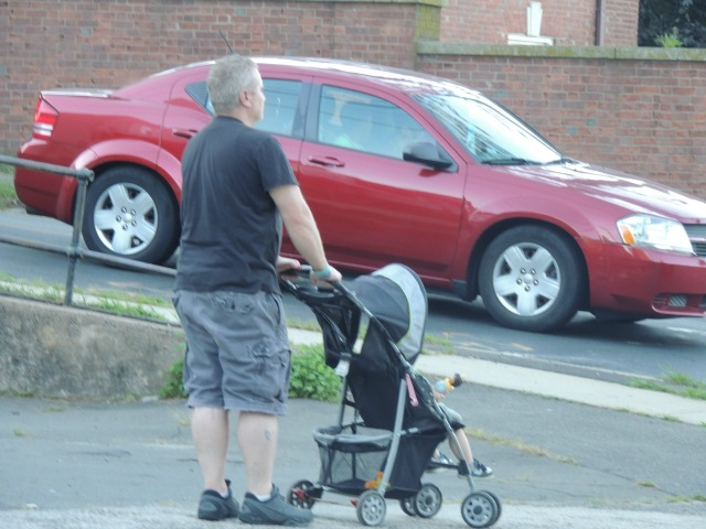 man with child in stroller,images