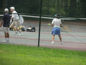 older man playing tennis, gifts for retirement
