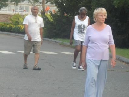 older women man walking for health together