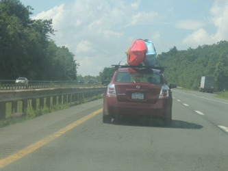 on highway kayak on car roof,gift for traveling man