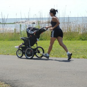 woman jogging with baby in stroller,love display