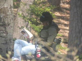 woman reading under tree in park,gift idea