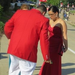 couple dressed in red prom outfit
