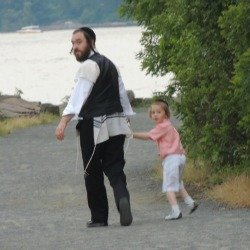 jewish father and son walking,on the beach-jewish presents