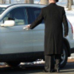 older man opening car door,a gentleman