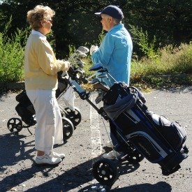 women golfers with caddy,retirement gifts for her