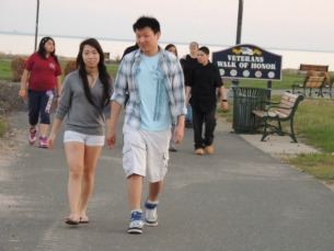 young asian couple walking on beach,pictures